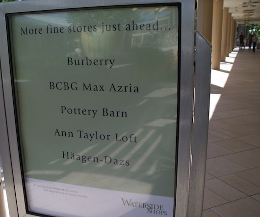 Sign with stores at Waterside Shops Mall in Naples Florida