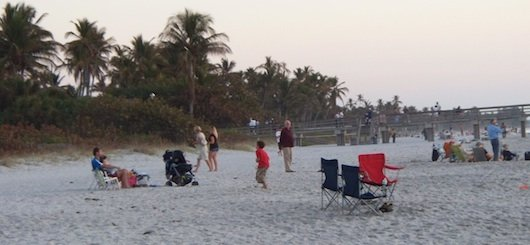Families hanging out at the beach by the Pier in Naples Florida