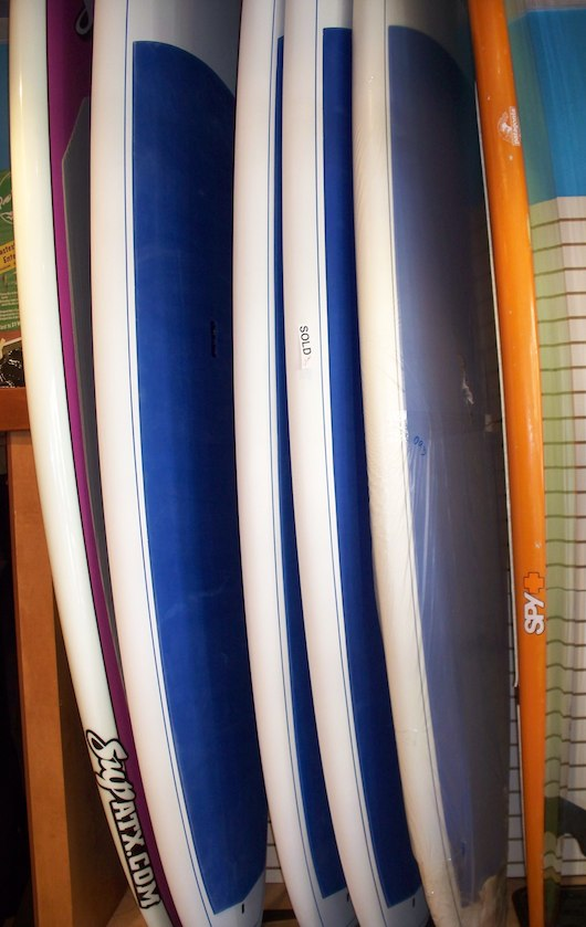 Surf boards and Paddleboards and Kiteboards at Olde Naples Surf Shop